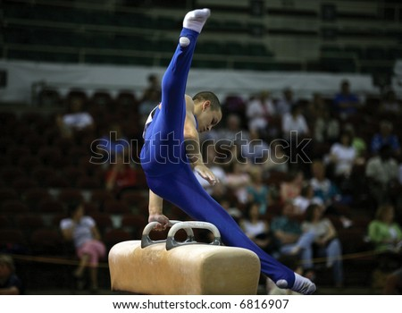 Young man competing on the pommel - stock photo