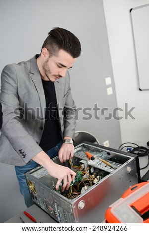 young man computer home repair fixing a computer