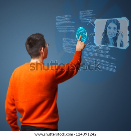 Young man connecting call center agent on digital interface - stock photo