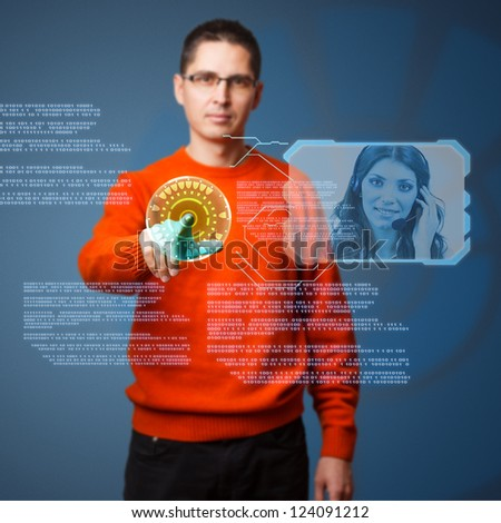Young man connecting helpline on digital interface - stock photo