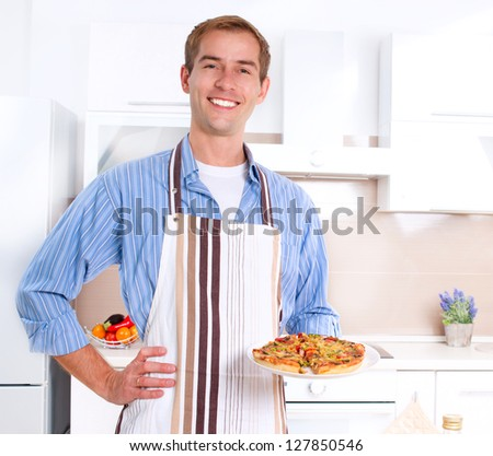 Young Man Cooking Pizza. Home. Kitchen - stock photo