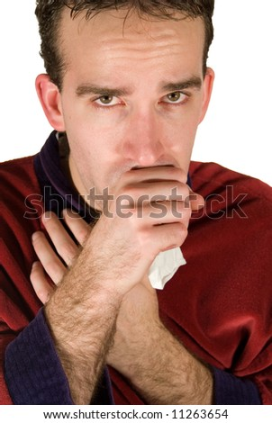 Young man coughing into his hand because he has a cold - stock photo