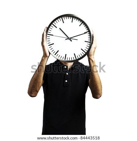 young man covering his face with a clock over white background