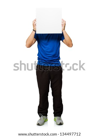 Young Man Covering His Face With Blank Placard Isolated On White Background