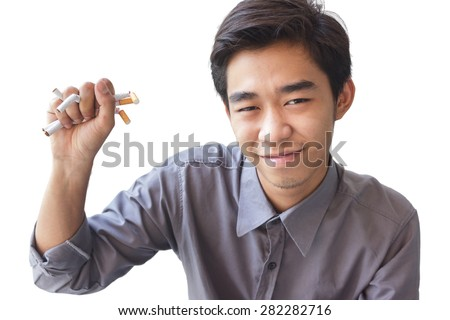 Young Man Crushing Cigarettes Concept No Smoking Isolated On background - stock photo
