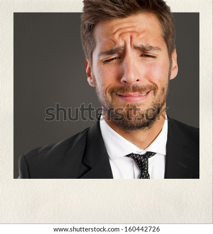 young man crying on photo frame