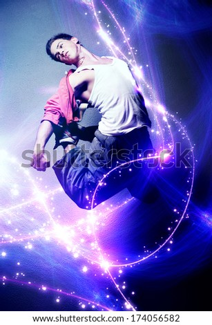 Young man dancer. With lights traces and sparks. - stock photo