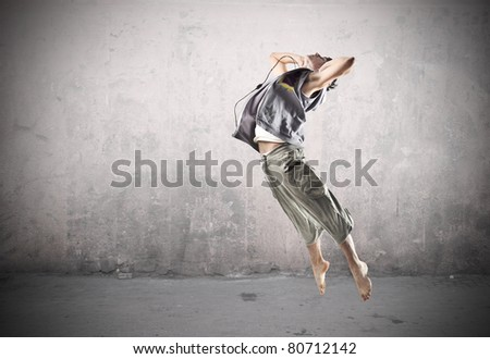 Young man dancing - stock photo
