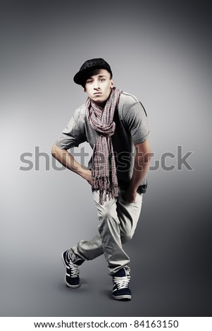 Young man dancing hip-hop at studio. - stock photo