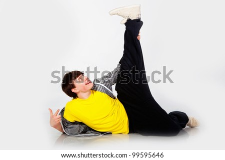 Young man dancing in studio - stock photo