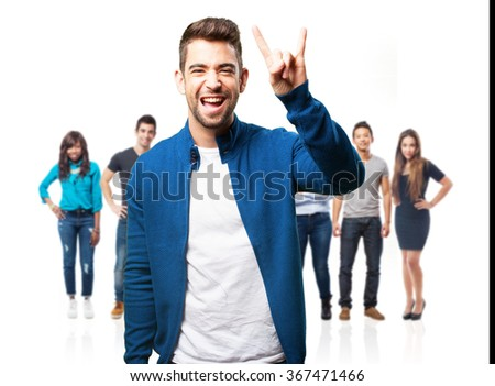 young man doing a rock gesture - stock photo