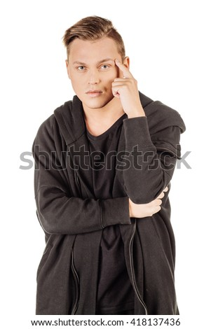 young man doing a suspicious gesture. emotions, facial expressions, feelings, body language, signs. image on a white studio background.