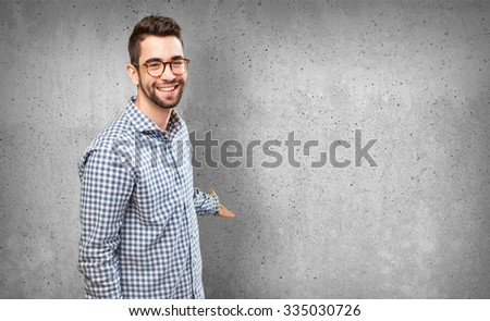 young man doing a welcome gesture - stock photo