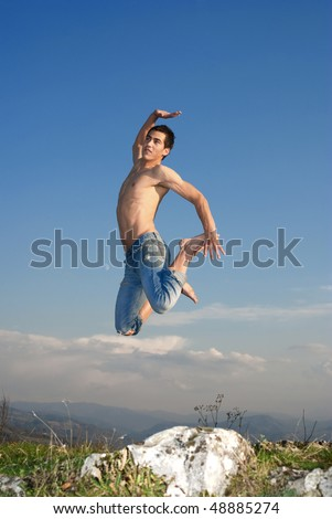 Young man doing gymnastics in the nature