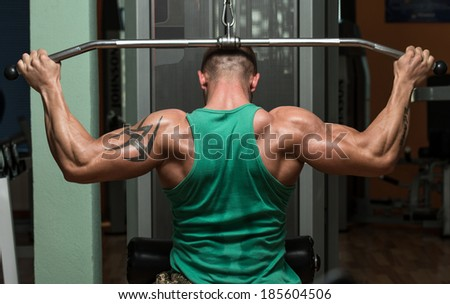 Young Man Doing Heavy Weight Exercise For Back - stock photo