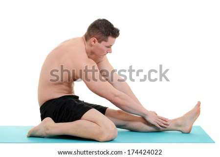 young man doing leg stretch