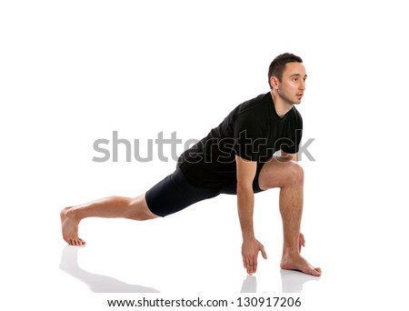 young man doing stretching and aerobics over white