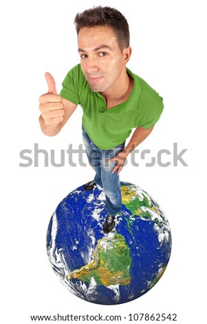 young man doing thumb up on top of a globe - elements of this image furnished by NASA - stock photo