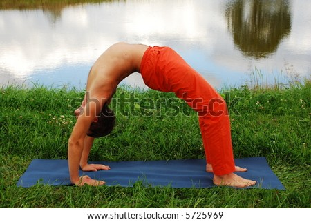 Young man doing yoga practice