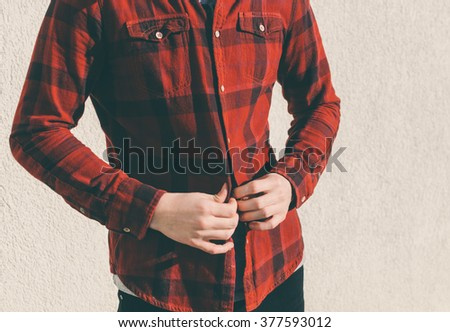 Young man dress a red vintage shirt