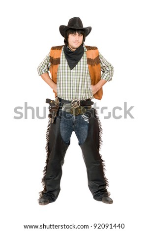Young man dressed as cowboy. Isolated on white - stock photo