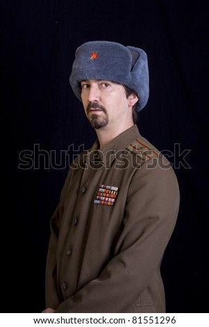 young man dressed as russian military, studio - stock photo