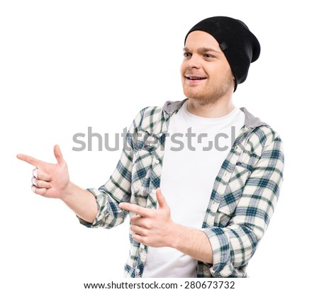 Young man dressed casual making pointing gesture on white background. - stock photo