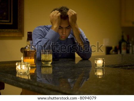young man drinking and feeling despair