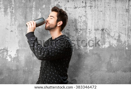 young man drinking beer - stock photo