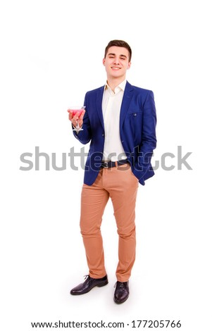 Young Man  Drinking Cocktail Isolated on the White Background - stock photo