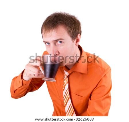 Young man drinking coffee on a white - stock photo