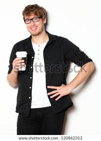 Young man drinking coffee portrait. Smiling happy male university student with drinking disposable coffee. Young male model in his twenties. - stock photo