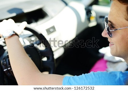 Young man driving a car - stock photo