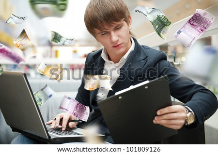 Young man earning money online - stock photo
