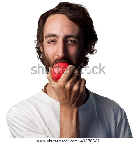 Young man eating a fresh apple