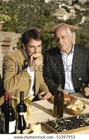 young man eating bread - stock photo