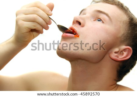 young man eating red caviar