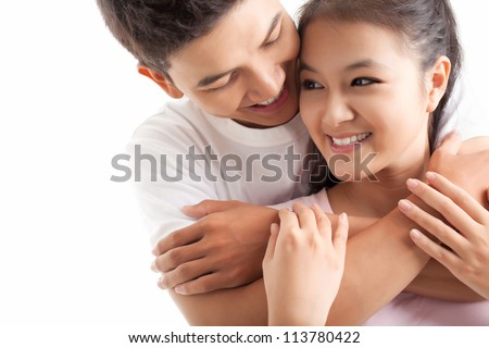 Young man embracing his girlfriend - stock photo