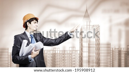 Young man engineer touching icon of media screen
