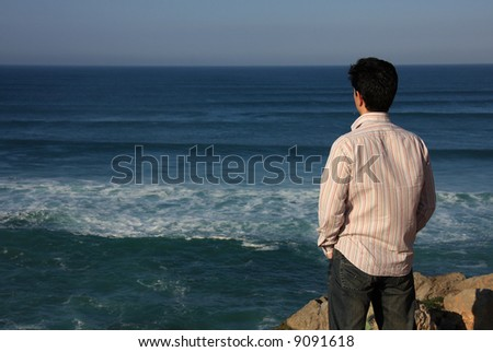 Young man enjoying a beautiful seascape - stock photo