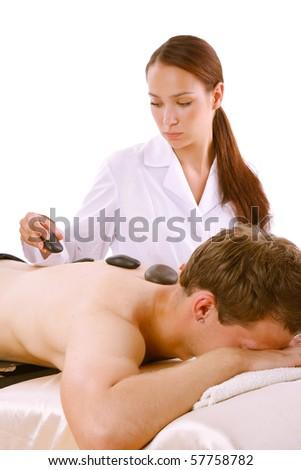 Young Man Enjoying Hot Stone Treatment - stock photo