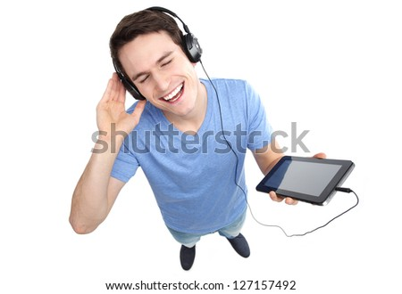 Young man enjoying music - stock photo