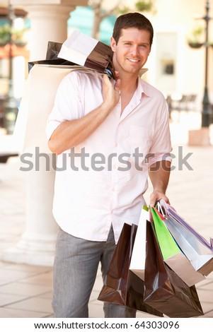 Young Man Enjoying Shopping Trip - stock photo