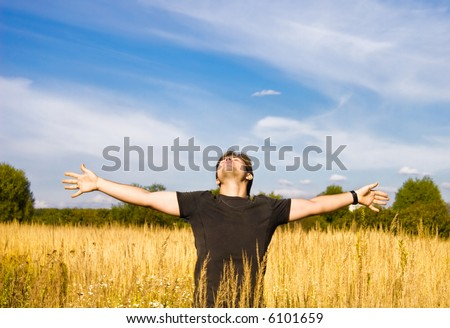 Young man enjoying the nature. - stock photo