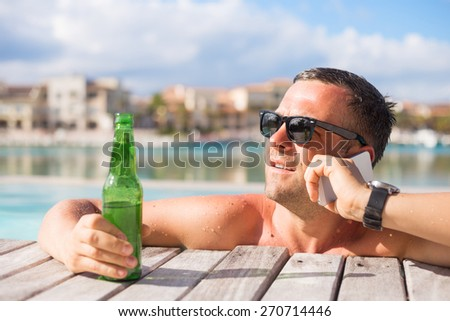 Young man enjoying vacation in luxury resort - stock photo
