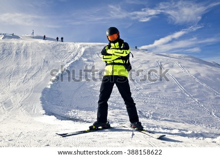 young man enjoying winter skiing