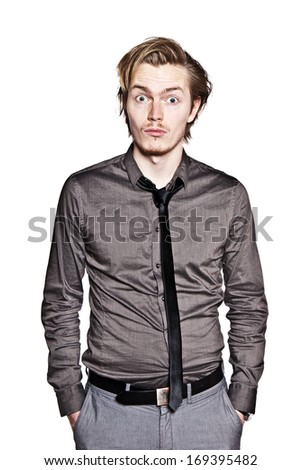 Young man expression portrait. Studio photo of surprised young man. - stock photo
