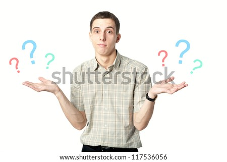 Young man facing a choice isolated on a white, holding a questions marks at her hands. - stock photo