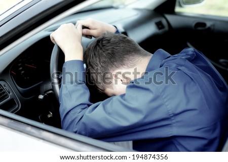 Young Man fall asleep in a Car - stock photo