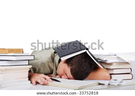 Young man fallen asleep after long reading - stock photo